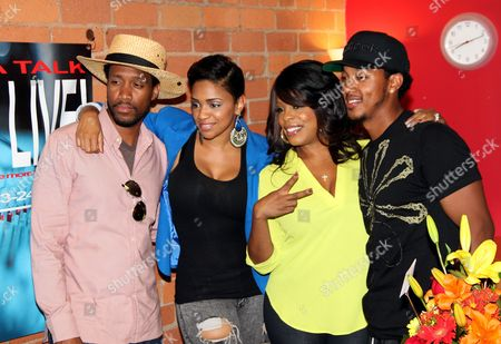 L-R) Radio personalities comedian JT Jackson, show host Staci Harris, special guest actress Niecy Nash and actor Wesley Jonathan pose at The Staci Harris Show at LA Talk Live, in Los Angeles, California