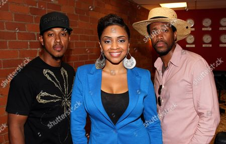 L-R) Radio personalities actor Wesley Jonathan, host Staci Harris, and comedian JT Jackson pose at The Staci Harris Show at LA Talk Live, in Los Angeles, California