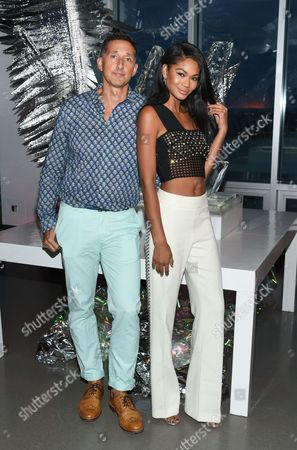 Model Chanel Iman poses with W Hotels Worldwide Global Brand Leader, Anthony Ingham, at an opening celebration party for the W Dubai Hotel at Glasshouses, in New York