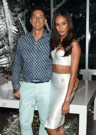 Stock Photo of Model Joan Smalls poses with W Hotels Worldwide Global Brand Leader, Anthony Ingham, at an opening celebration party for the W Dubai Hotel at Glasshouses, in New York