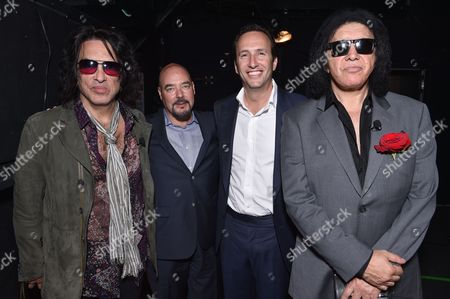 """Paul Stanley, left, and Gene Simmons, right, of the musical group KISS, and from left, Joel Stillerman, EVP of original programming, production and digital content, AMC, and Charlie Collier, President and General Manager, AMC, pose backstage at the """"4th and Loud"""" AMC summer TCA panel at the Beverly Hilton Hotel, in Beverly Hills, Calif"""