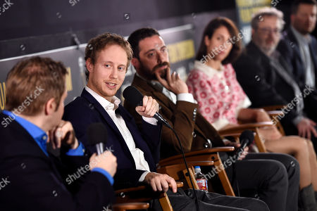 """Stock Photo of Laszlo Nemes, second from left, director of the Golden Globe Best Foreign Language Film nominee """"Son of Saul,"""" answers a question from moderator Mike Goodridge, left, at the Golden Globe Foreign-Language Film Symposium at the Egyptian Theatre, in Los Angeles. Looking on from left behind Nemes are directors Pablo Larrain, Deniz Gamze Erguven, Jaco Van Dormael and Klaus Haro"""