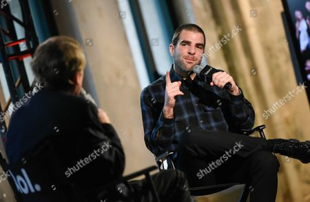 """Actor Zachary Quinto, right, chats with moderator Peter Travers during AOL's BUILD Speaker Series to discuss his new television show """"The Slap"""", at AOL Studios, in New York"""