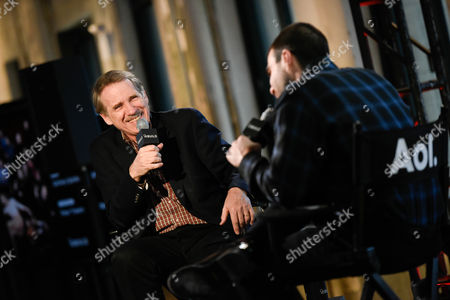 """Moderator Peter Travers, left, chats with actor Zachary Quinto during AOL's BUILD Speaker Series to discuss his new television show """"The Slap"""", at AOL Studios, in New York"""