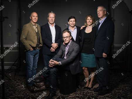 """Actor Michael Keaton, from left, Boston Globe's former deputy managing editor Ben Bradlee Jr., reporter Michael Rezendes, columnist and reporter Sacha Pfeiffer, editor Walter Robinson, and writer/director Thomas McCarthy pose for a portrait during press day for """"Spotlight"""" at The Four Seasons, in Los Angeles. The power of Spotlight, which opens Friday, isn't just felt by its real-life reporters; it's a big-screen bolt of inspiration for a beleaguered profession and a certain entry into the canon of great films about journalism. While the film's attributes are numerous, its greatest strength is its rigorous depiction of investigative journalism and its celebration of an increasingly endangered species of news gathering"""