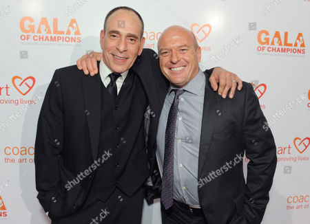 Nestor Serrano, left, and Dean Norris arrive at the CoachArt Gala of Champions held at The Beverly Hilton, in Beverly Hills, Calif