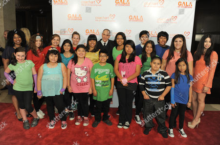 Nestor Serrano, center, Thyonne Gordon, left, and CoachArt kids arrive at the CoachArt Gala of Champions held at The Beverly Hilton, in Beverly Hills, Calif