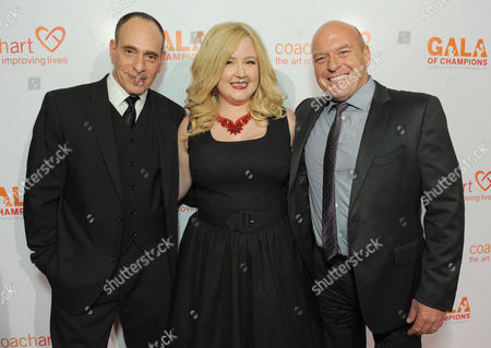 From left, Nestor Serrano, Katrina Parker and Dean Norris arrive at the CoachArt Gala of Champions held at The Beverly Hilton, in Beverly Hills, Calif