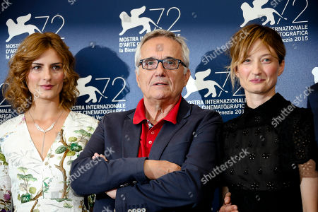 Actresses Lidiya Liberman, left, and Alba Rohrwacher pose with director Marco Bellocchio, center, during the photo call for the film Sangue Del Mio Sangue (Blood of my blood) at the 72nd edition of the Venice Film Festival in Venice, Italy, . The 72nd edition of the festival runs until Sept. 12