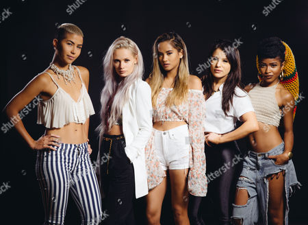 Stock Photo of From left, Paula Van Oppen, Lauren Bennett, Emmalyn Estrada, Natasha Slayton, and Simone Battle of the band, G.R.L. pose for a photo at The Beverly Hilton in Beverly Hills, Calif. Their self-titled new album released on July 29, 2014