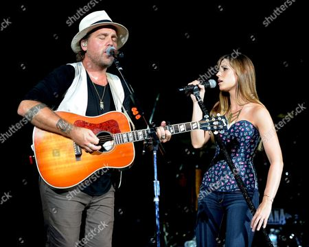 Tom Gossin and Rachel Reinert of Gloriana perform during the Rewind Tour at the Cruzan Amphitheater on in West Palm Beach, Florida
