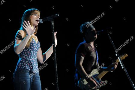 Rachel Reinert and Mike Gossin of Gloriana perform during the Rewind Tour at the Cruzan Amphitheater on in West Palm Beach, Florida