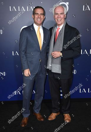 """Los Angeles Mayor Eric Garcetti, left, and his father Gil Garcetti arrives at the Los Angeles premiere of """"La La Land"""" at The Village Theatre Westwood on"""