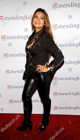 """Actress Nia Peeples poses at the Mending Kids """"Rock N' Roll All Star Event"""", in West Hollywood, Calif"""