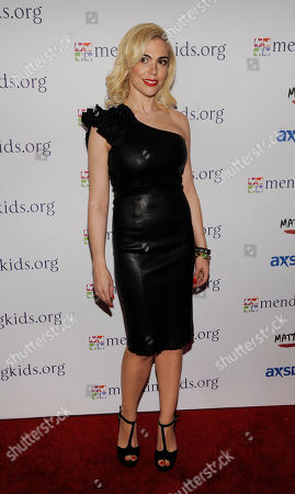 "Brenna Whitaker poses at the Mending Kids ""Rock N' Roll All Star Event"", in West Hollywood, Calif"