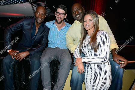 From left, retired Hall of Fame National Football League player Jerry Rice, former U.S. Olympic swimmer Michael Phelps, Charlotte Bobcats owner Michael Jordan and fiancee model Yvette Prieto attend the Michael Jordan Celebrity Invitational opening night dinner, Wednesday, April, 3, 2013 in Las Vegas