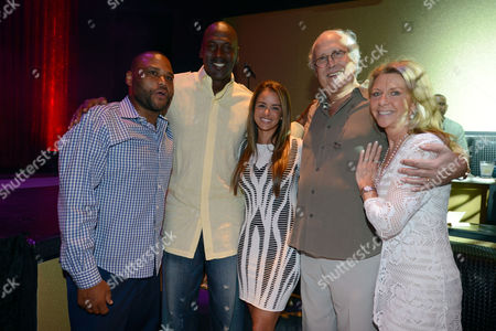 From left, actor Anthony Anderson, Charlotte Bobcats owner Michael Jordan and his fiancee model Yvette Prieto, actor Chevy Chase and wife Jayni Chase attend the Michael Jordan Celebrity Invitational opening night dinner, Wednesday, April, 3, 2013 in Las Vegas