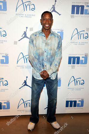 Former Major League Baseball player Kenny Lofton arrives at the Michael Jordan Celebrity Invitational opening night dinner, Wednesday, April, 3, 2013 in Las Vegas