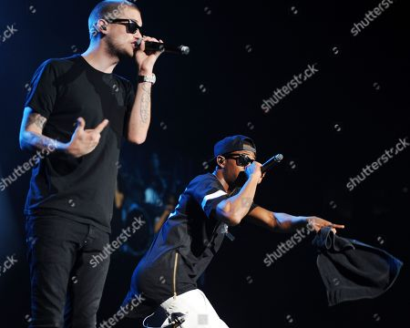 Tony Oller and Malcolm Kelley of MKTO perform during the Demi World Tour at the American Airlines Arena on in Miami, Florida