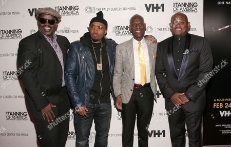 """From left, recording artists Fab Five Freddy and Nas, fashion designer Dapper Dan and author Steve Stoute attend a screening of """"The Tanning of America: One Nation Under Hip Hop"""" on in New York"""
