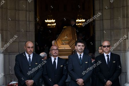 People stand aoutside the church for the funerals of Liliane Bettencourt in Neuilly sur Seine, outside Paris, . Liliane Bettencourt, the L'Oreal cosmetics heiress and the world's richest woman, has died at her home in a chic Parisian suburb. She was 94