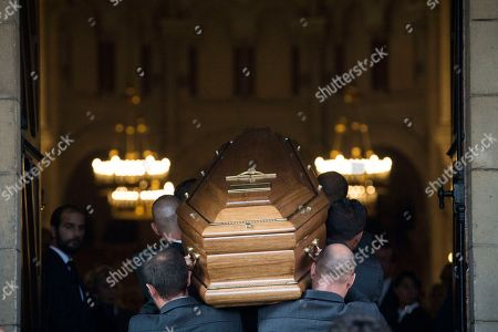 The coffin of Liliane Bettencourt is carried into the church in Neuilly sur Seine, outside Paris, . Liliane Bettencourt, the L'Oreal cosmetics heiress and the world's richest woman, has died at her home in a chic Parisian suburb. She was 94
