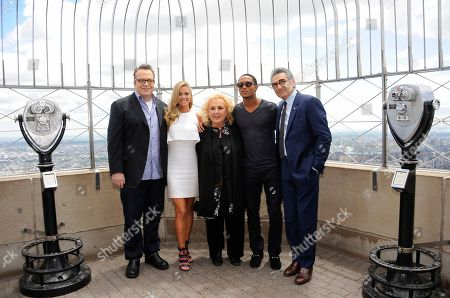 "Cast members of ""Tyler Perry's Madea's Witness Protection"", from left, Tom Arnold, Denise Richards, Doris Roberts, Romeo Miller and Eugene Levy visit the observation deck at the Empire State Building on in New York"