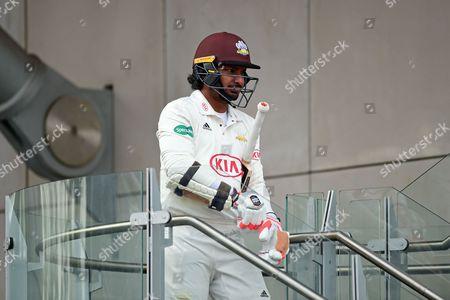 Kumar Sangakkara heads out to bat for the last time