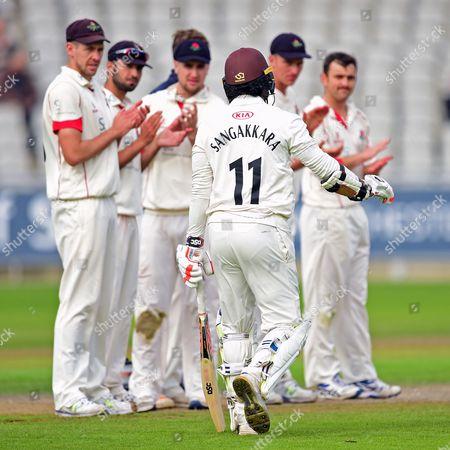 Kumar Sangakkara gets a guard of honour from the Lancashire players