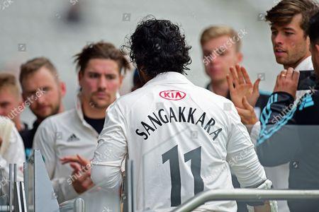 Kumar Sangakkara applauded by his team mates
