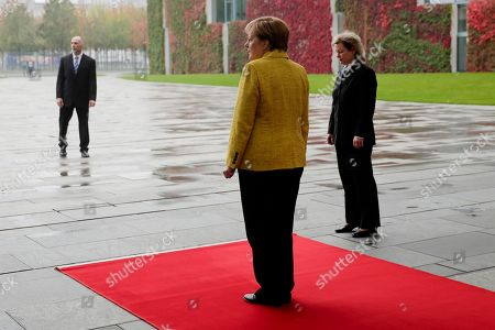 German Chancellor Angela Merkel stands on the red carpet as she waits for the arrival of Georgian Prime Minister Giorgi Kvirikashvili for talks at the chancellery in Berlin