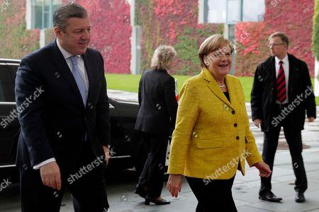 German Chancellor Angela Merkel, second from right, welcomes Georgian Prime Minister Giorgi Kvirikashvili, left, for talks at the chancellery in Berlin
