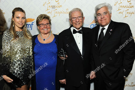 From left, Cassandra Mann, Claudia Mann, Alfred Mann and Jay Leno arrive at the 10th annual Alfred Mann Foundation Gala, in Beverly Hills, Calif