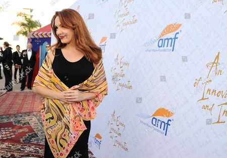 Amy Yasbeck arrives at the 10th annual Alfred Mann Foundation Gala, in Beverly Hills, Calif