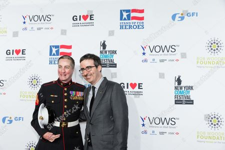 Marine corporal Aaron Mankin, left, and John Oliver pose at the 9th Annual Stand Up For Heroes, presented by the New York Comedy Festival and The Bob Woodruff Foundation, at the Theater at Madison Square Garden, in New York