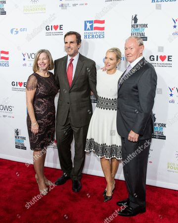 Stock Image of Bob Woodruff, second from left, Lee Woodruff, and Army General Martin E. Dempsey arrive at the 9th Annual Stand Up For Heroes, presented by the New York Comedy Festival and The Bob Woodruff Foundation, at the Theater at Madison Square Garden, in New York
