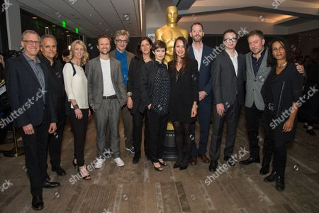 "Rob Epstein, left, Dirk Wilutzky, Rory Kennedy, Orlando von Einsiedel, Wim Wenders, Laura Poitras, Mathilde Bonnefoy, Joanna Natasegara, Charlie Siskel, Keven McAlester, Juliano Ribeiro Salgado and Tabitha Jackson arrive at the 87th Academy Awards - ""Documentaries"" at the Samuel Goldwyn Theatre on in Beverly Hills, Calif"
