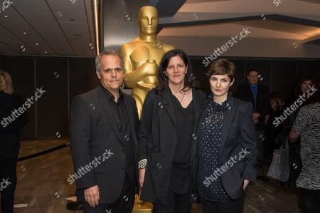 """Dirk Wilutzky, left, Laura Poitras and Mathilde Bonnefoy arrive at the 87th Academy Awards - """"Documentaries"""" at the Samuel Goldwyn Theatre, in Beverly Hills, Calif"""