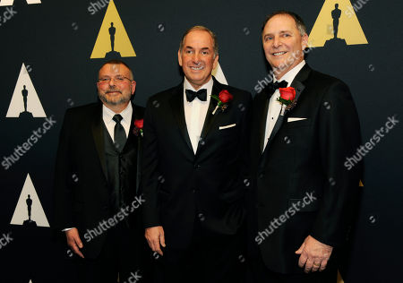 Stock Picture of Michael Fecik, left, Steven Tiffen, center, and Jeff Cohen, recipients of the Academy Award of Commendation for their pioneering work in developing dye-based filters that reduce IR contamination when neutral density filters are used with digital cameras, pose together at the Academy of Motion Picture Arts and Sciences' 87th Scientific and Technical Awards at the Beverly Wilshire Hotel, in Beverly Hills, Calif