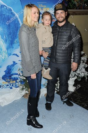 Jack Osbourne and Lisa Stelly with daughter Andy attend Frozen celebrity premiere presented by Disney On Ice held at the Staples Center on Thursday, Dec.10, 2015, in Los Angeles