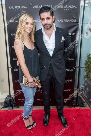 Emily Wickersham, left, and Anil Arjandas attend the grand opening of the Anil Arjandas Jewels Los Angeles Boutique on in Los Angeles