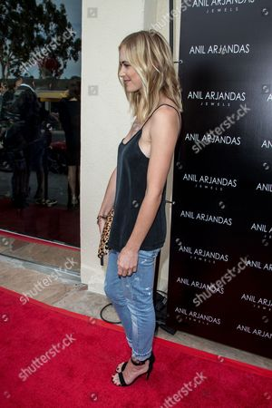 Emily Wickersham attends the grand opening of the Anil Arjandas Jewels Los Angeles Boutique on in Los Angeles