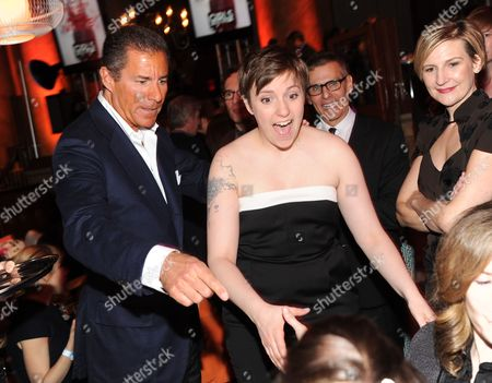 """HBO CEO Richard Plepler, left, """"Girls"""" creator and actress Lena Dunham, Michael Lombardo, HBO programming president, and Sue Naegle, HBO Entertainment president, attend the HBO """"Girls"""" premiere after party at Capitale on in New York"""