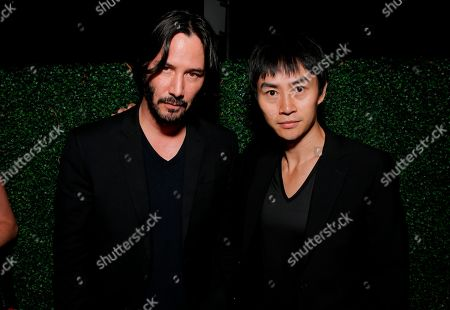 Stock Picture of Keanu Reeves, left, and Tiger Chen attend InStyle & Hollywood Foreign Press Association's Annual Toronto International Film Festival Party, hosted by Salvatore Ferragamo, held at the Windsor Arms Hotel in Toronto