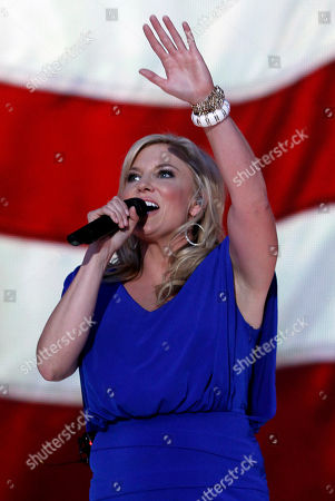 Julie Roberts performs the National Anthem at the 2012 CMA Music Festival on in Nashville, Tenn