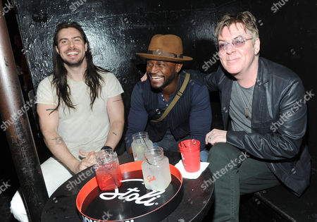 Stoli's Professor of The Party Andrew W.K., left, Taye Diggs, center, and The Smith's Andy Rourke, Rock and Roll Hall of Fame nominee, celebrate 35 years of nightlife at The Pyramid Club on Avenue A as part of The Scene By Stoli Project, in New York