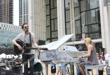 "Arthur Darvill and Joanna Christie, of ONCE, the Tony Award-winning musical, kick off a day of free concerts as part of the celebration of ""Art for All"" and the conclusion of the Sing for Hope Pianos project, supported by Chobani, Inc., at Lincoln Center, in New York"