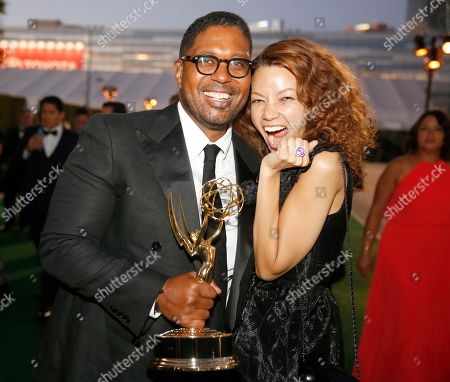 Jayson Jackson, left, and guest, pose with the award for outstanding documentary or nonfiction special at the Governors Ball during night two of the Television Academy's 2016 Creative Arts Emmy Awards at the Microsoft Theater on in Los Angeles