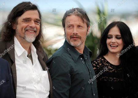 From left, Kristian Levring, Mads Mikkelsen and Eva Green during a photo call for The Salvation at the 67th international film festival, Cannes, southern France