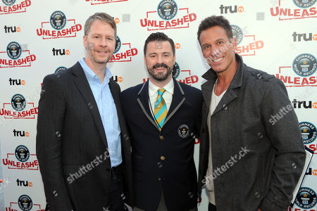 Stock Picture of Chris Linn, truTV President and Head of Programming, Stuart Claxton and Dan Cortese pose at the truTV & GUINNESS WORLD RECORDS event celebrating the premiere of the Guinness World Records Unleashed series, in New York's Times Square